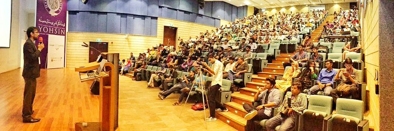Me (left) giving a talk at Google I/O Extended Karachi 2019